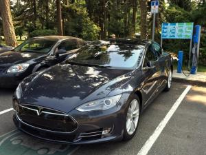 Tesla Model S parked at charging station