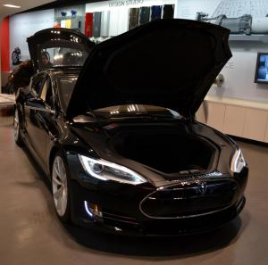 Tesla Model S with hood up to show no engine.