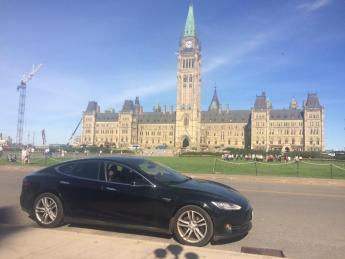 Tesla parked outside of Parliament hill in Ottawa